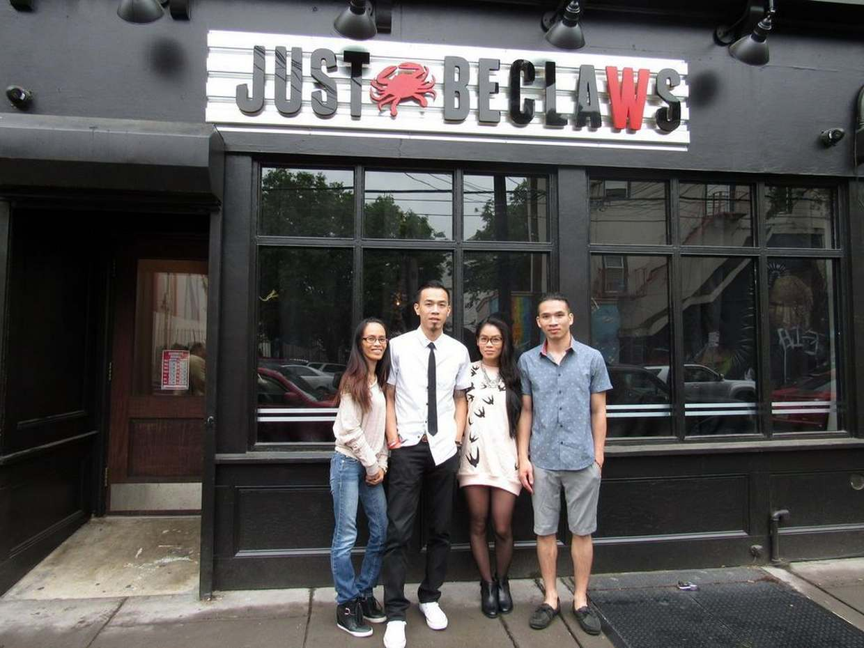 Owners of Just BeClaws stand in front of their new Jersey City restaurant.