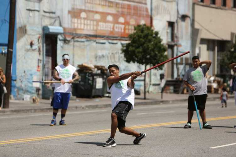 Jersey City sports teams play stickball.