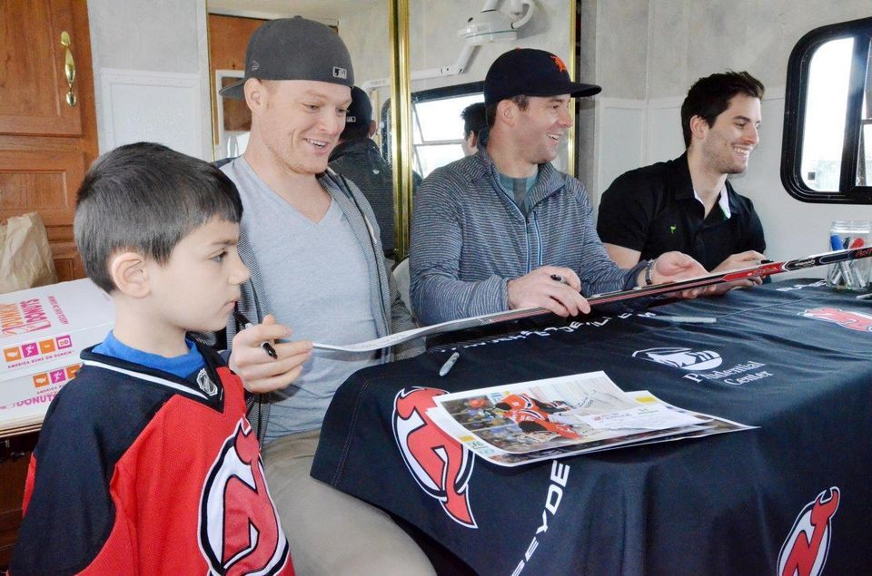 Jersey City animal shelter hosts fundraiser with New Jersey Devils players.
